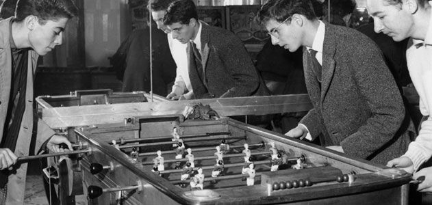 Young players playing Foosball 1958